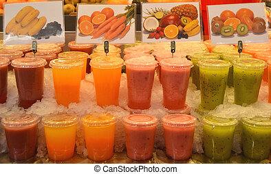 Fruit juices in La Boqueria, famaous marketplace in...