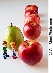 Girl and Boy Discussing Healthy Nutrition - Toy girl and boy...