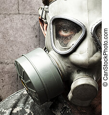 soldier with gas mask - portrait of young soldier wearing...