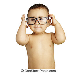 portrait of funny kid shirtless wearing glasses over white...