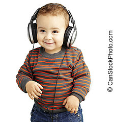portrait of a handsome kid listening to music and smiling over w