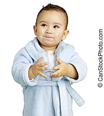 portrait of adorable infant with blue bathrobe holding a...