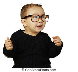 portrait of adorable kid wearing glasses and gesturing over whit