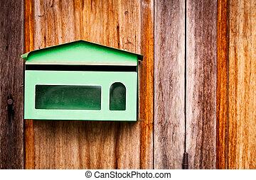 Green Post Box at the Door