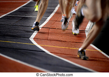 Running a Race - Runner running a race around a track with...