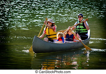 Family Canoeing at Lake - Family in a canoe on a lake in the...