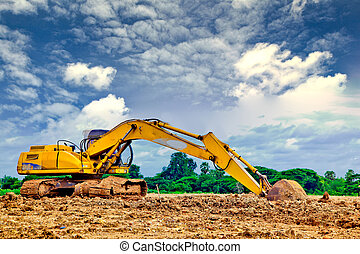 back hoe digger loose track against blue sky and white cloud
