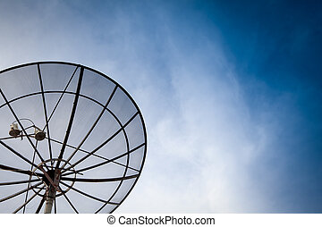 black satelite dish beside FM boardcast antenna in black and...