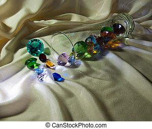 Overturned glass with gems