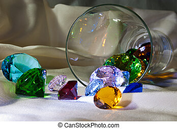 Overturned glass with colour gems - Overturned glass with...