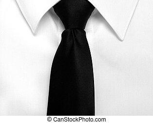 Black Tie Affair - Closeup of white shirt and black tie with...