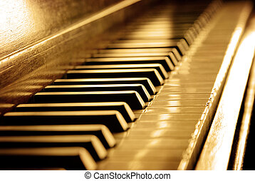 Sepia Piano Keys - Closeup of black and white piano keys and...