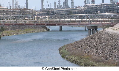 Industrial River - river running through industrial factory...