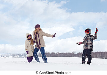 Kids and woman enjoy the snow