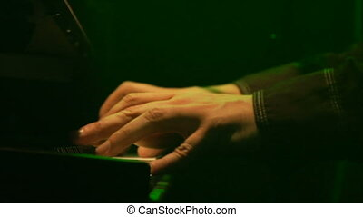 Rock n Roll Keyboard - This is a close up shot of a hand...