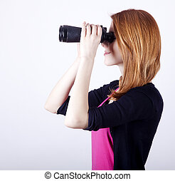 Teen redhead girl with binoculars