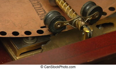 music box mechanism cu - This is a close up of an antique...