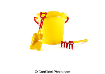 Toy bucket, spade and rake on a white background
