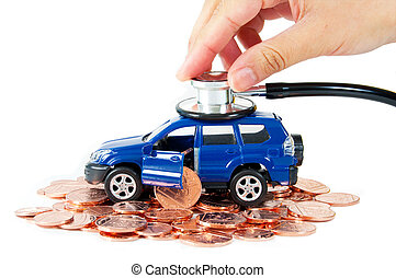 Car insurance - Toy car with a stethoscope on top of stacks...