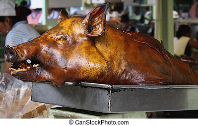 Roast pig - Roast Pig for sale at the market in Ecuador. It...
