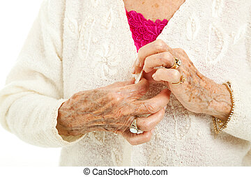 Difficulties of Arthritis - Senior womans arthritic hands...