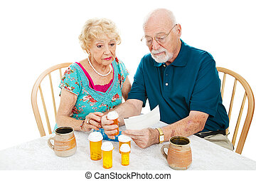Reading Instructions from Pharmacy - Senior couple reading...