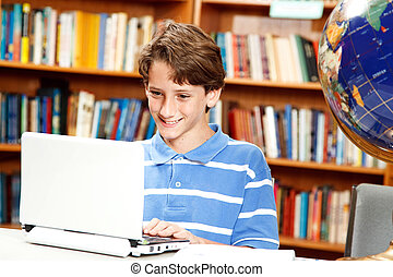 Boy Uses Computer in School
