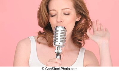 Singer Using A Microphone - Close-up image of the face of a...