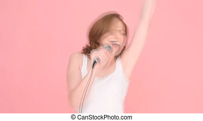 Laughing Woman Holding Microphone - Laughing vivacious woman...
