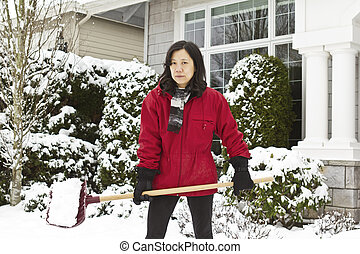 Hard Working Women - Women working outside cleaning snow in...