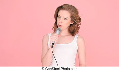 Woman Explaining Something Using Microphone, isolated studio...