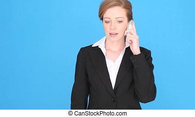 Excited Businesswoman Using Mobile Phone with her fist and...