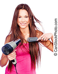 woman blow dryer and comb - woman with long hair holding...