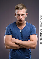 The tough guy. - Portrait of masculine tough looking young...