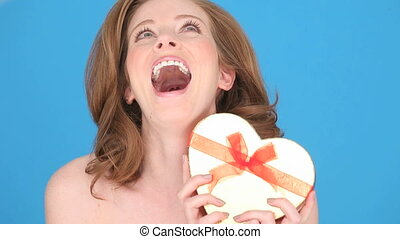 Smiling Woman Holding Heart-shaped