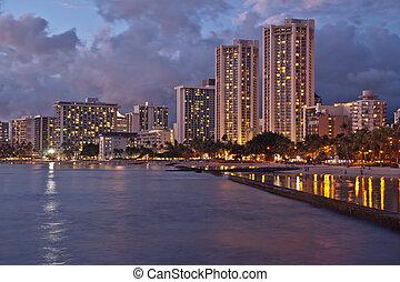 Waikiki Beach, Oahu Island Hawaii, cityscape sunset -...