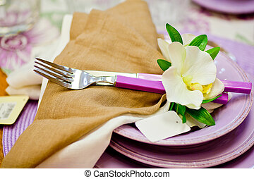 Forks and flowers on top of dishes