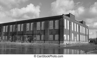 Abandoned Factory. Timelapse. B W. - A large factory,...