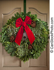 Christmas Wreath - Christmas wreath with red ribbon handing...