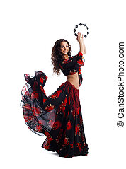 Young woman dance in gypsy with tambourine