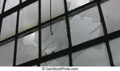 Broken factory window. Timelapse, - A large window at an...