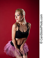 Athletic young woman posing in dance rose costume