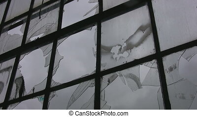 Broken factory window. Timelapse. - A large window at an...