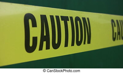 Caution tape - Yellow caution tape on green background