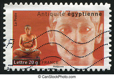 Egyptian Statue of Seated Scribe - FRANCE - CIRCA 2007:...