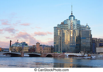 Sampsonievsky bridge and Modern building on Neva river in...