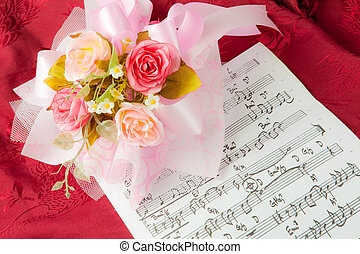 Rose on the musical notes page