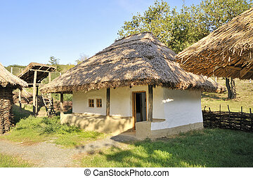 traditional  rural cottage with a straw roof