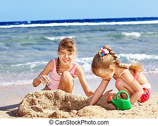 Children playing on beach - Little girl playing on beach...