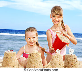 Kids playing on  beach. - Children playing on  beach.